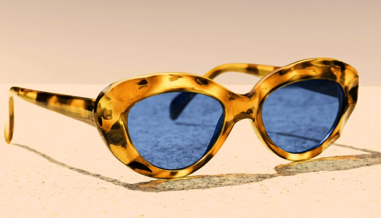 women's sunglasses with black glasses in a yellow frame